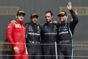 Charles Leclerc, Ferrari, 2nd position, Lewis Hamilton, Mercedes, 1st position, the Mercedes trophy delegate and Valtteri Bottas, Mercedes, 3rd position, on the podium