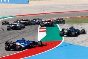 Sebastian Vettel, Aston Martin AMR21, and Fernando Alonso, Alpine A521, chase the frontrunners at the start