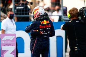 Sergio Perez, Red Bull Racing, and pole man Max Verstappen, Red Bull Racing, congratulate each other after Qualifying