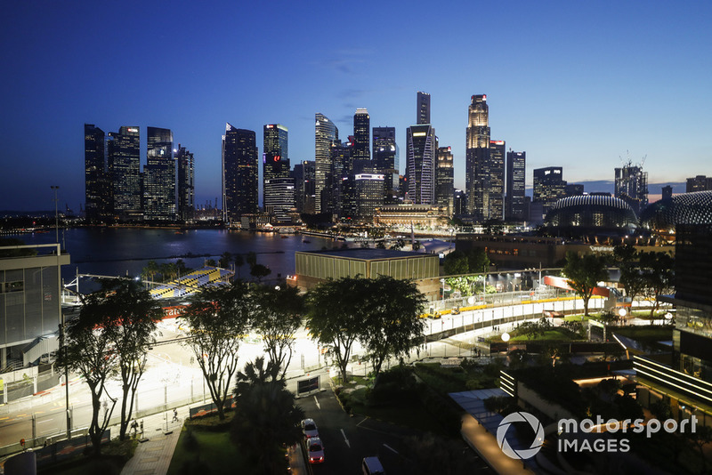 The track is built as darkness falls over the Singapore skyline