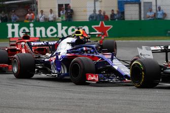 Pierre Gasly, Toro Rosso STR13, leads Sebastian Vettel, Ferrari SF71H, and Daniel Ricciardo, Red Bull Racing RB14
