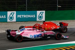 Sebastian Vettel, Ferrari SF71H facing the wrong way after making contact with Lewis Hamilton, Mercedes AMG F1 W09 while Sergio Perez, Racing Point Force India VJM11 drives past