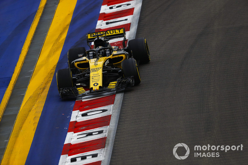 Nico Hulkenberg, Renault Sport F1 Team R.S. 18, runs wide over a kerb and strikes up sparks