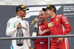 Lewis Hamilton, Mercedes AMG F1, 2nd position, David Sanchez, Principal Aerodynamicist, Ferrari, and Sebastian Vettel, Ferrari, 1st position, celebrate on the podium with Champagne