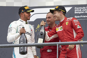 Lewis Hamilton, Mercedes AMG F1, 2nd position, David Sanchez, Principal Aerodynamicist, Ferrari, and Sebastian Vettel, Ferrari, 1st position, celebrate on the podium with Champagne