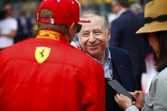 Jean Todt, President, FIA, talks to Kimi Raikkonen, Ferrari, on the grid