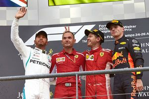 Lewis Hamilton, Mercedes AMG F1, 2nd position, David Sanchez, Principal Aerodynamicist, Ferrari, Sebastian Vettel, Ferrari, 1st position, and Max Verstappen, Red Bull Racing, 3rd position, on the podium