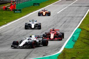 Sergey Sirotkin, Williams FW41, leads Sebastian Vettel, Ferrari SF71H, Lance Stroll, Williams FW41, and Fernando Alonso, McLaren MCL33