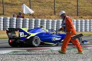 Leonardo Pulcini, Campos Racing drives past a marshal on the gravel