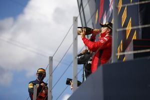 Max Verstappen, Red Bull Racing, 2nd position, Lewis Hamilton, Mercedes-AMG F1, 1st position, and Charles Leclerc, Ferrari, 3rd position, celebrate with Champagne on the podium