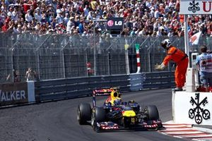 A marshal signals Mark Webber, Red Bull RB7 Renault, to slow down