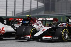 Kevin Magnussen, Haas VF-20, and Romain Grosjean, Haas VF-20