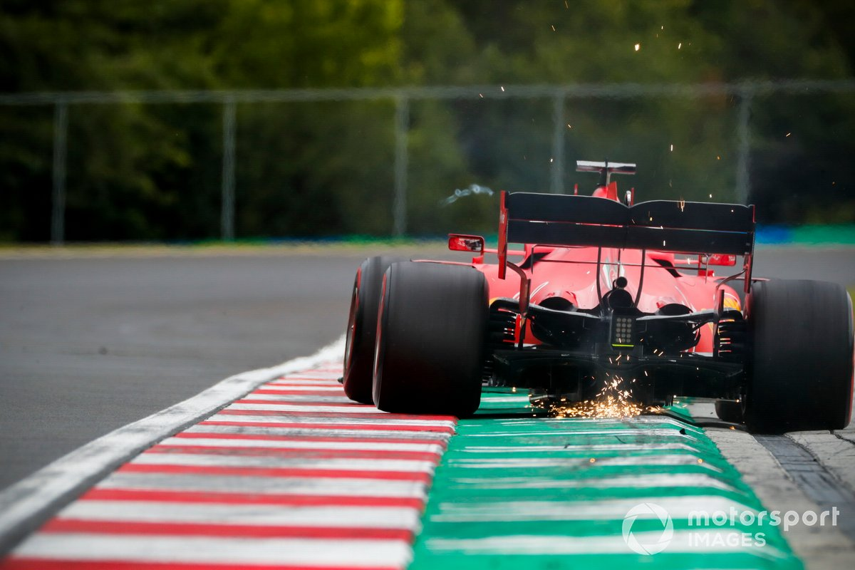 Sparks kick up from Sebastian Vettel, Ferrari SF1000