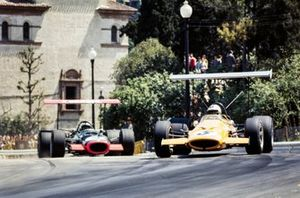 Denny Hulme, McLaren M7A Ford, leads Pedro Rodriguez, BRM P126