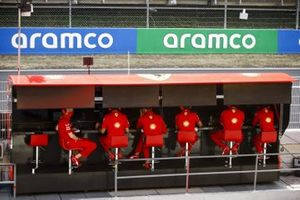 The Ferrari team on the pit wall