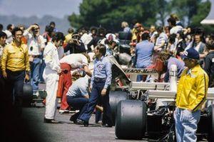 Bernie Ecclestone walks through the pit lane