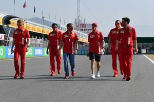 Sebastian Vettel, Ferrari, Marc Gene and other team members walk the circuit