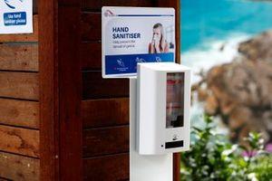A hand sanitiser dispenser in the paddock
