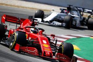 Sebastian Vettel, Ferrari SF1000, leads Daniil Kvyat, AlphaTauri AT01