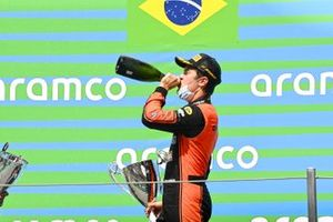 Race Winner Felipe Drugovich, MP Motorsport celebrates on the podium with the champagne