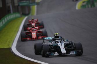 Valtteri Bottas, Mercedes AMG F1 W09 EQ Power+, leads Kimi Raikkonen, Ferrari SF71H, and Sebastian Vettel, Ferrari SF71H