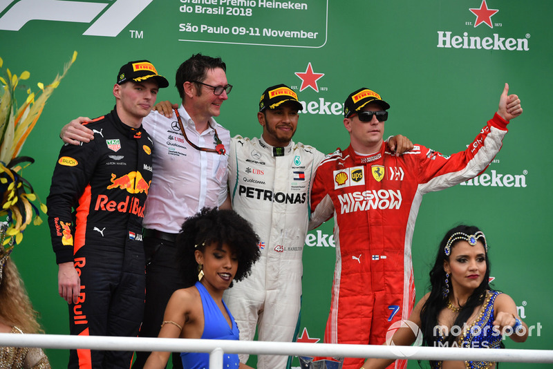 (L to R): Max Verstappen, Red Bull Racing, Andy Shovlin, Mercedes-AMG F1 Chief Engineer, Lewis Hamilton, Mercedes AMG F1 and Kimi Raikkonen, Ferrari celebrate on the podium with the samba girls