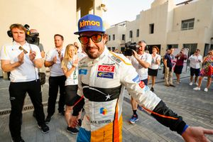 Fernando Alonso, McLaren, walks into the garage to the cheers of his team