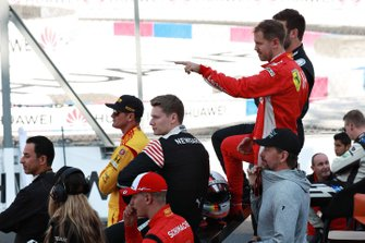 The drivers watch the track action