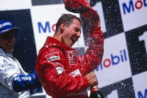 Michael Schumacher, Ferrari, celebrates his 1st position on the podium
