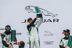 AM class victor Alice Powell, Jaguar VIP car on the podium