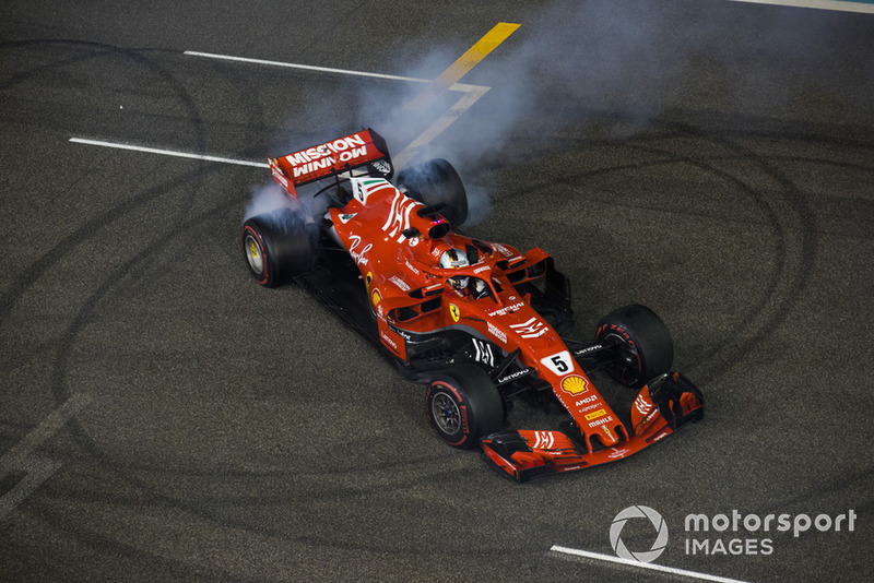 Sebastian Vettel, Ferrari, 2nd position, performs donuts on the grid at the end of the race