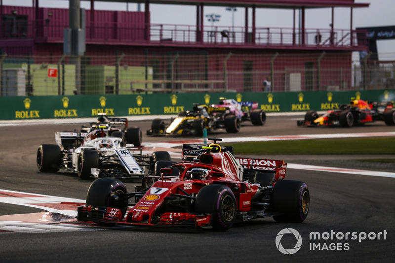 Kimi Raikkonen, Ferrari SF71H, leads Charles Leclerc, Sauber C37, Romain Grosjean, Haas F1 Team VF-18, and Nico Hulkenberg, Renault Sport F1 Team R.S. 18, and the remainder of the field at the start