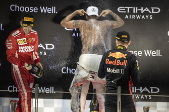 Sebastian Vettel, Ferrari, Lewis Hamilton, Mercedes AMG F1 and Max Verstappen, Red Bull Racing celebrate on the podium with the champagne