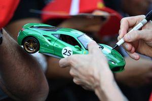 Kimi Raikkonen, Ferrari signs autograph for a fan on a model Ferrari