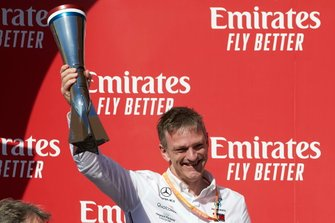 James Allison, Technical Director, Mercedes AMG, lifts his winning constructor's trophy