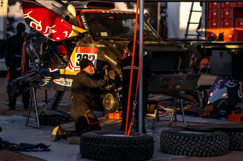 Bahrain JCW X-Raid Team mechanic works after stage