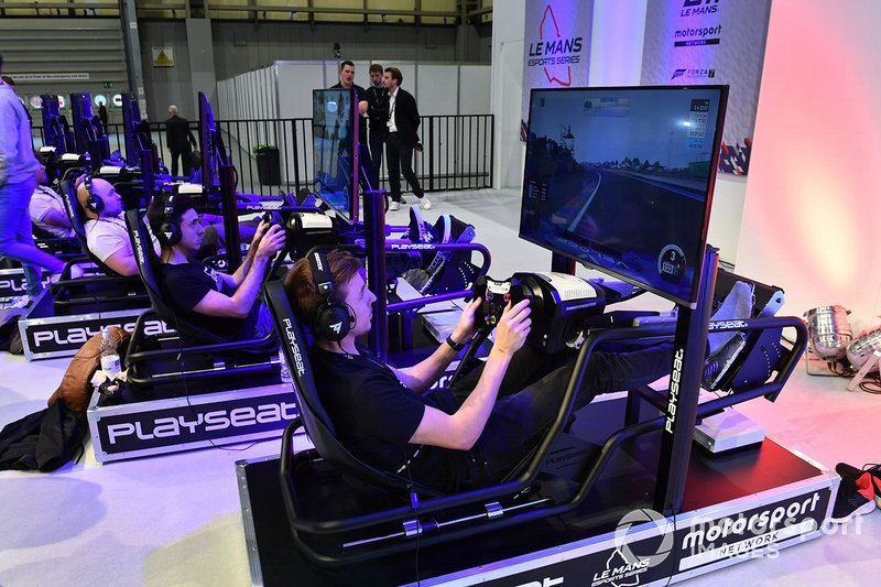 Fans enjoy the simulator rigs on the Le Mans eSports Series stand