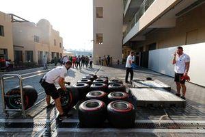 Mercedes mechanics prepare some tyres