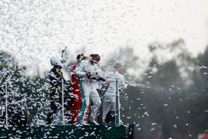 Race winner Lewis Hamilton, Mercedes AMG F1, Sebastian Vettel, Ferrari and Mario Achi, Mexican GP Promoter celebrate on the podium with the champagne