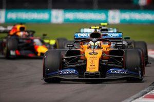 Lando Norris, McLaren MCL34, leads Valtteri Bottas, Mercedes AMG W10, and Max Verstappen, Red Bull Racing RB15