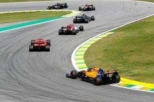 Kevin Magnussen, Haas F1 Team VF-19, leads Antonio Giovinazzi, Alfa Romeo Racing C38, Charles Leclerc, Ferrari SF90, and Lando Norris, McLaren MCL34