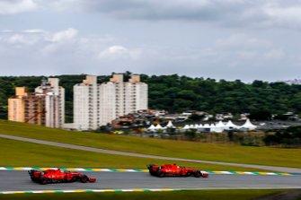 Sebastian Vettel, Ferrari SF90 leads Charles Leclerc, Ferrari SF90