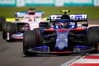 Pierre Gasly, Toro Rosso STR14, leads Sergio Perez, Racing Point RP19