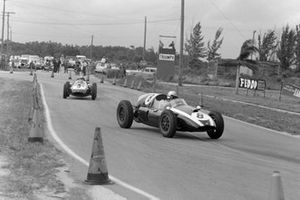 Jack Brabham, Cooper T51 Climax, leads Bruce McLaren, Cooper T51 Climax