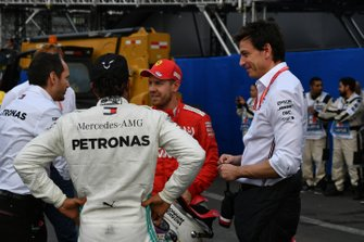 Toto Wolff, Executive Director (Business), Mercedes AMG, with Sebastian Vettel, Ferrari, 2nd position, and Lewis Hamilton, Mercedes AMG F1, 1st position, after the race