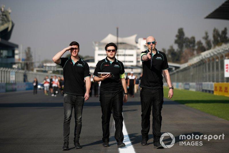 Members of the Panasonic Jaguar Racing team walk the track