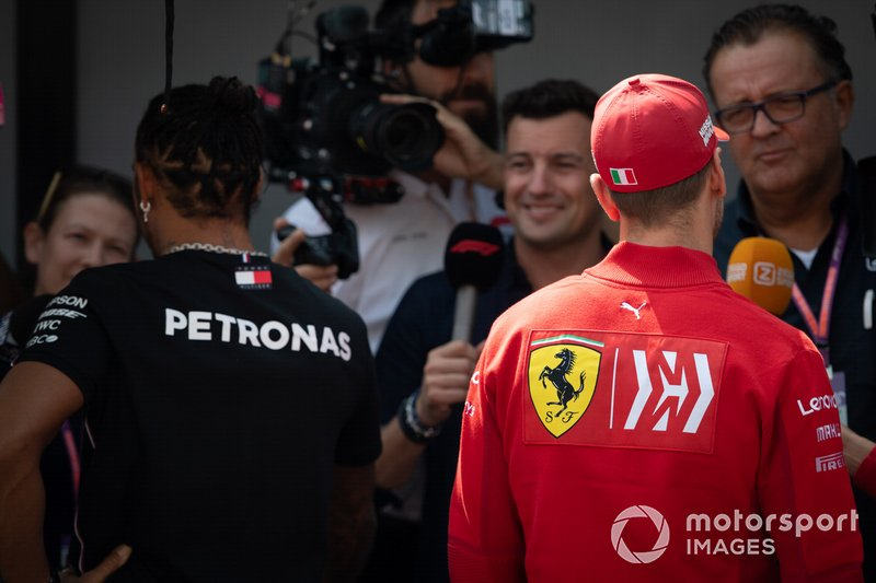 Lewis Hamilton, Mercedes AMG F1 and Sebastian Vettel, Ferrari talk to the media