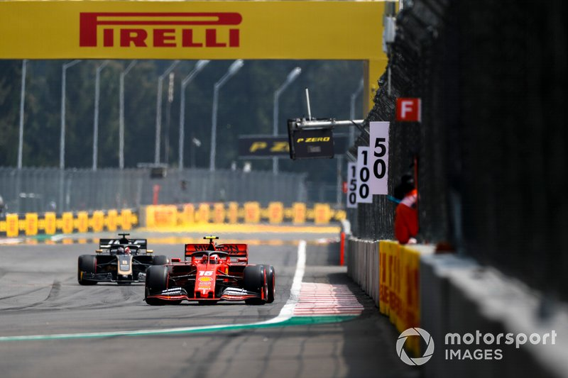 Charles Leclerc, Ferrari SF90, leads Romain Grosjean, Haas F1 Team VF-19