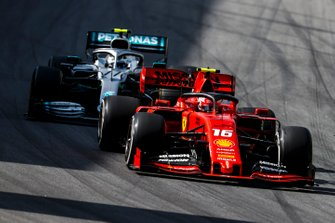 Charles Leclerc, Ferrari SF90 and Valtteri Bottas, Mercedes AMG W10 battle