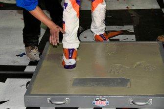 Denny Hamlin, Joe Gibbs Racing, Toyota Camry FedEx Express, celebrates in victory Lane after winning the Daytona 500.